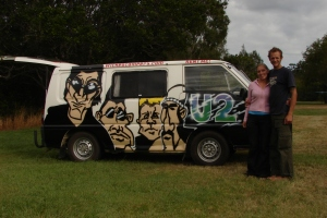 stood by our U2 decorated Wicked Campervan.  Backpacking in Australia.  2006